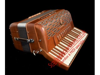 Paolo Soprani Folk 37 key 96 bass 4 voice wood accordion.  Midi expansion available.