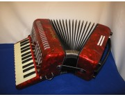 New red stephanelli accordion with 26 treble keys and 12 bass